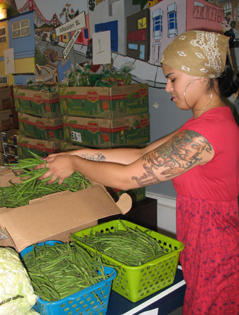 Teen volunteer at Outer Mission pantry
