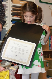 Phoebe with her certificate from the San Francisco Food Bank